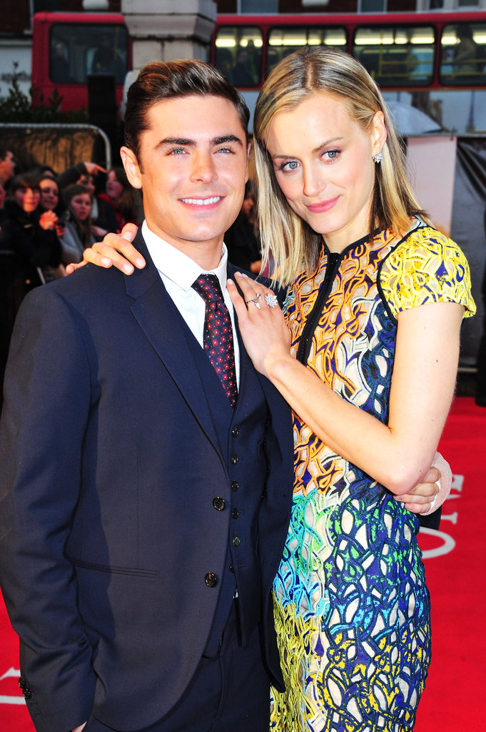 Zac Efron and Taylor Schilling posed together at the premiere of The Lucky One in London.