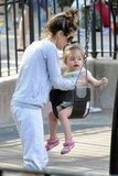 Sarah Jessica Parker pushed her daughters on the swings at the park in NYC.