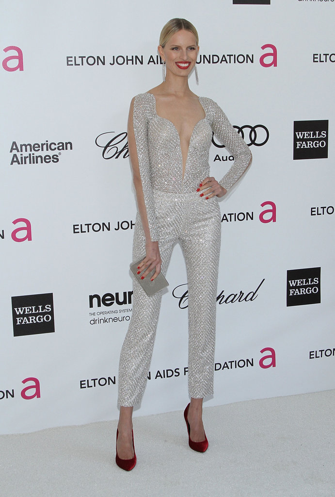 Karolina Kurkova made a memorable Oscar party arrival in a sequined jumpsuit — and heels to match her bright red lips.