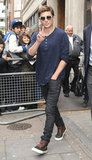 Zac Efron waved to fans while leaving BBC Radio in London.