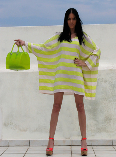 We love this Summer-ready play on stripes — the kind of neon you could wear just as easily to dinner as you could to the pool.  Photo courtesy of Lookbook.nu