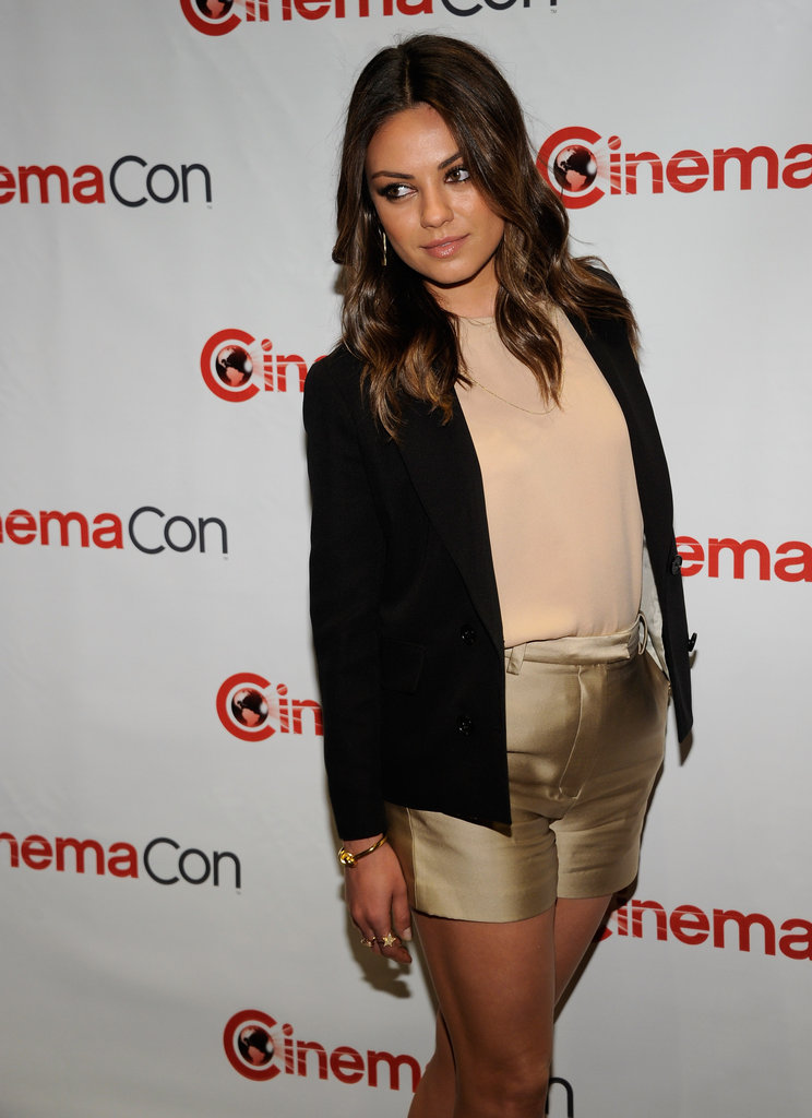 Mila Kunis sported gold shorts and a black blazer at CinemaCon.