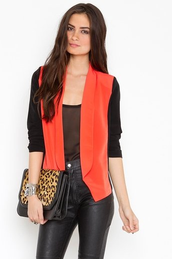 We'd wear this colorblock blazer with white shorts and ankle booties.  Nasty Gal Dark Side Blazer ($68)