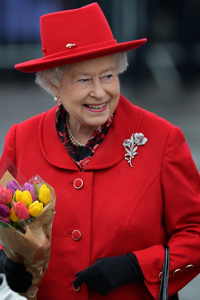 The queen looked bright in red.