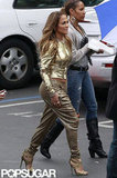 Jennifer Lopez stepped out of her trailer in stilettos and gold harem pants.