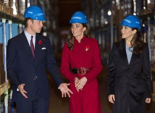 Prince William, Kate Middleton (in a pretty red long coat), and the Crown Princess Mary of Denmark visited the UNICEF emergency supply center in Copenhagen during November 2011.