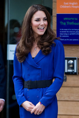 In March 2012, Kate donned this blue Reiss suit dress with a black belt.
