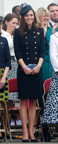 She channeled a military vibe in this navy buttoned-up Alexander McQueen dress and matching navy blue fascinator.