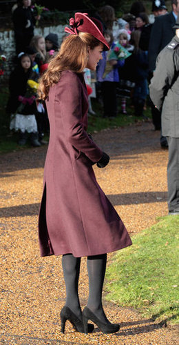 A side view of Kate's burgundy coat and fascinator on Christmas morning.
