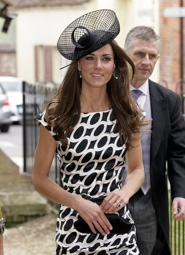 Kate Middleton wore an oval-printed Zara dress with Links of London earrings and an Anya Hindmarch clutch to a family friend's wedding last year.