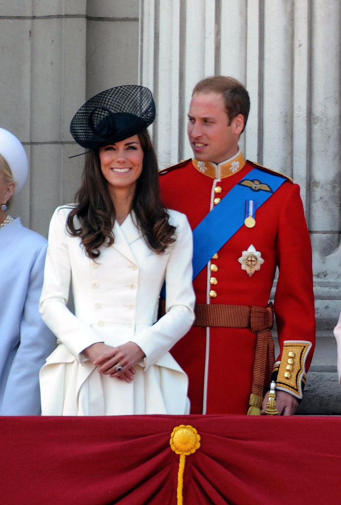 Her tailored white jacket and striking black fascinator looked positively regal as they stood on the balcony of Buckingham Palace following the Trooping the Color ceremony in 2011.
