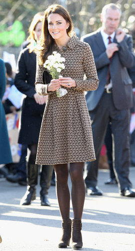 The Duchess of Cambridge arrived at Rose Hill Primary School during a visit to Oxford, England, in February 2012. For the occasion, she donned a pretty printed brown dress with brown tights and dark brown suede booties.