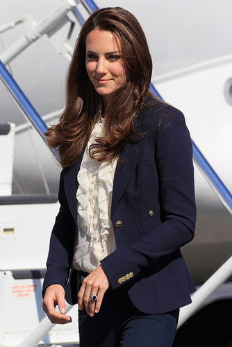 The Duchess of Cambridge chose a ruffle-font House of Fraser cream blouse with a navy Smythe blazer and J Brand skinny jeans for a day in Alberta, Canada, in July 2011.