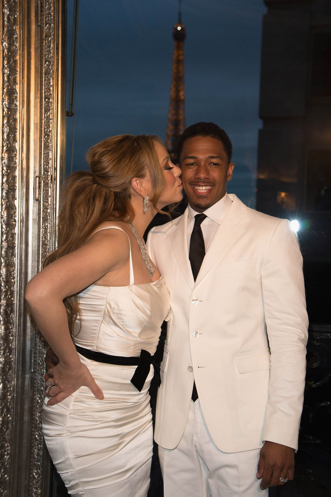 Mariah Carey planted a kiss on the cheek of her groom, Nick Cannon.