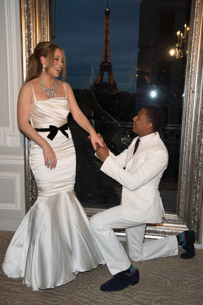 Nick Cannon wore colorful socks under his white suit.