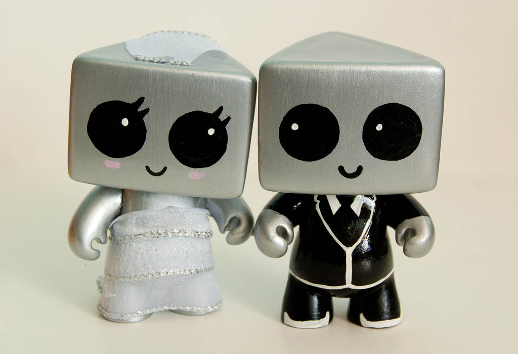 The Robots in Love Wedding Cake Topper ($40) can be customized to match your dress, veil, and the groom's tuxedo. We're loving their bright marble eyes and bot heads!