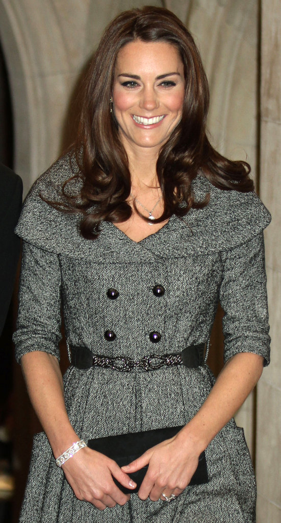 We love that she accessorized her chic gray Jesire coat dress with a funkier waist belt and a sparkly diamond bracelet.