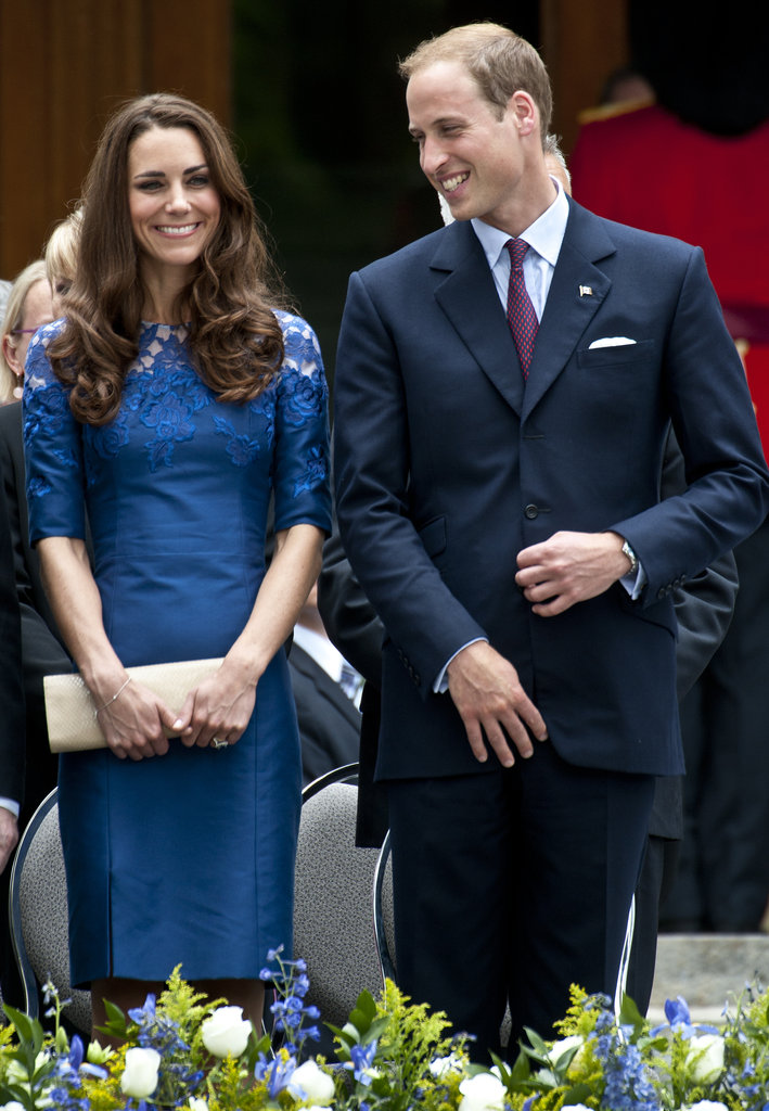 The couple were all smiles during their tour through Canada last Summer. Kate donned a blue lace-shouldered Erdem dress and toted a long cream clutch to offset the bold hue.