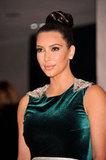 Kim Kardashian wore her hair in an elegant bun.
