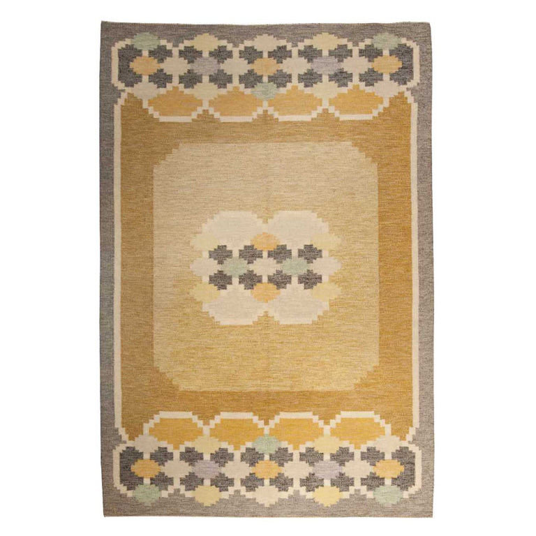 Rich golden hues make up the patterns on this Vintage Swedish Rug ($26,000).