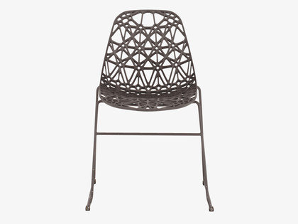 Resembling a loose-form weave, the Zach Black Plastic Dining Chair ($280) is thoroughly modern, even as it references crochet techniques.