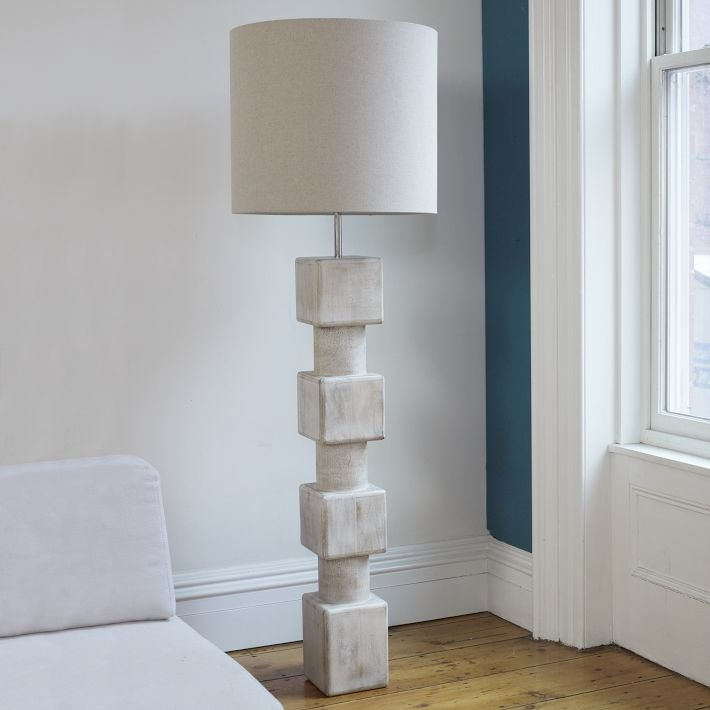 The Totem Floor Lamp ($400) is made from a whitewashed mango wood base with a linen shade