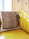 The chocolate brown background on the Brown Geometric Pillow ($49) makes the design really pop.