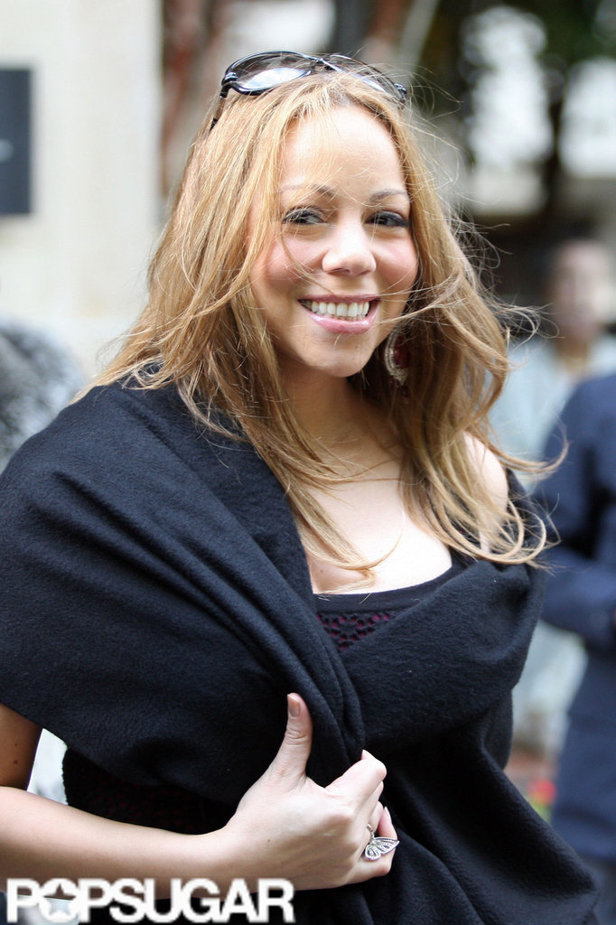 Mariah Carey gave a smile as she headed out of her hotel in Paris.