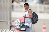 Nick Cannon held Monroe Cannon in a carrier while traveling home from the airport in Paris.