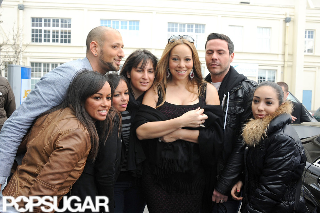 Mariah Carey posed with a group of fans while leaving her hotel in Paris.
