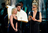 Elisha Cuthbert, Adam pally and Eliza Coupe were silly on stage at the Comedy Awards in NYC.