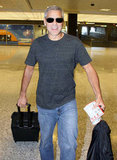 George Clooney rolled his own luggage.