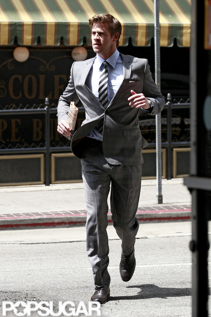 Liam Hemsworth jogged across the street in a suit for a Men's Health photo shoot in LA.
