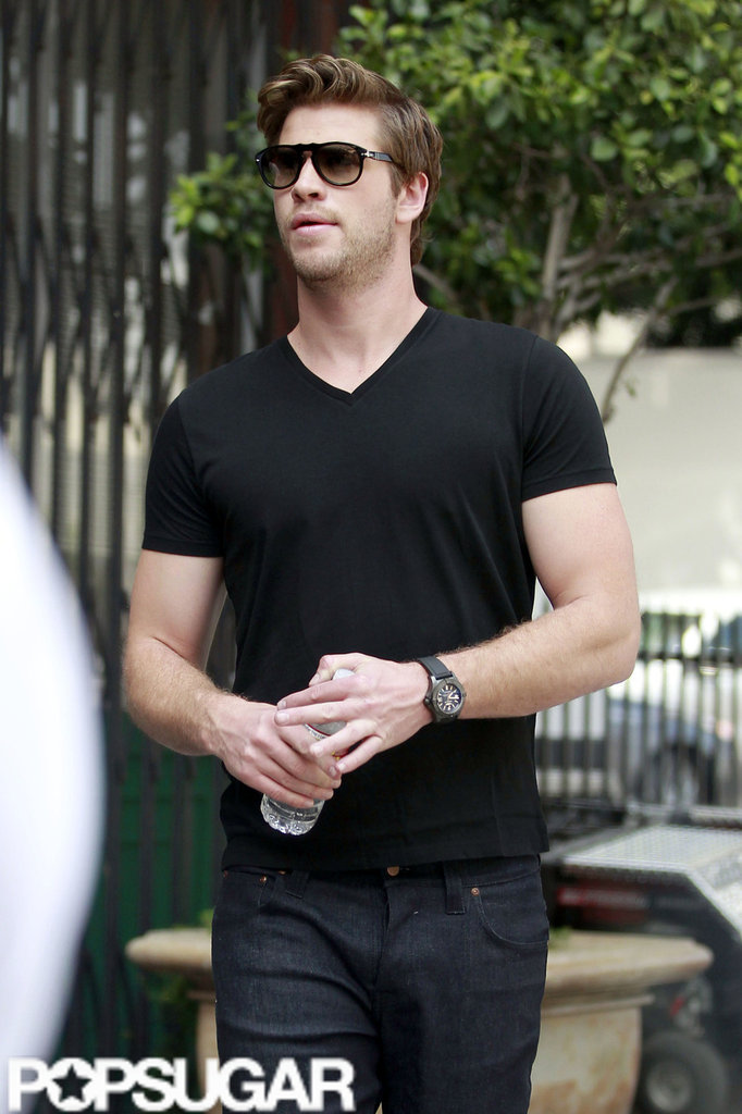 Liam Hemsworth changed out of a suit into a black t-shirt and jeans after a Men's Health photo shoot in LA.
