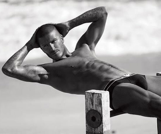 David Beckham flexed his muscles in an Armani ad.