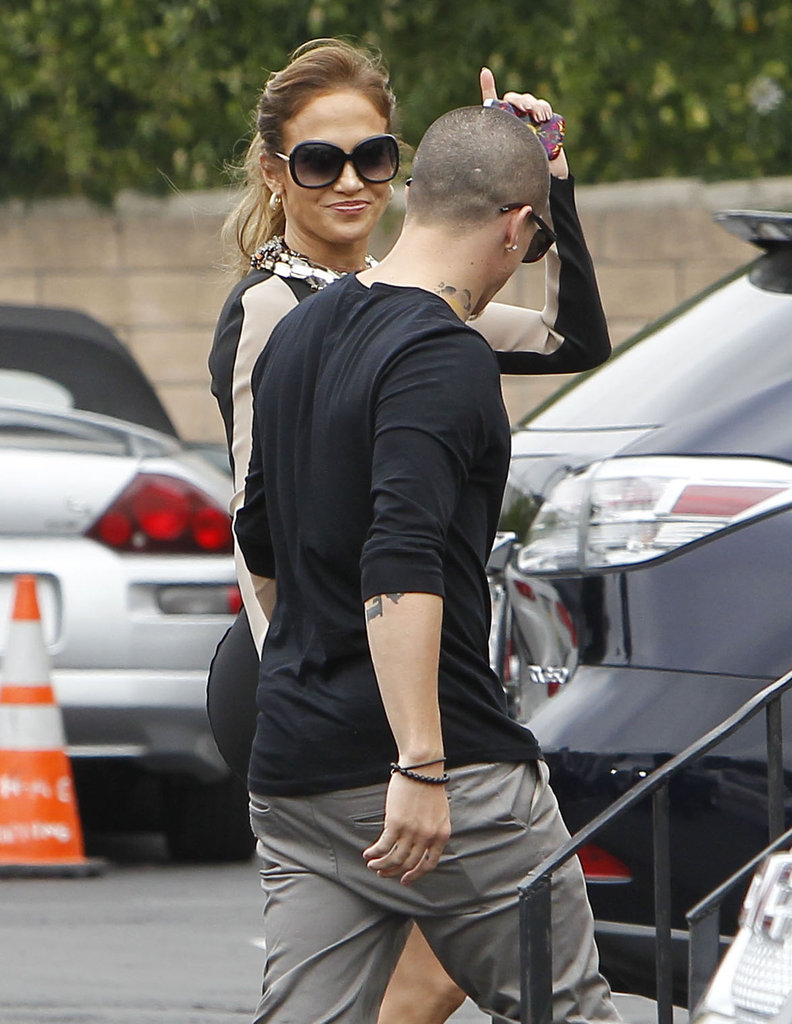 Jennifer Lopez gave a wave while holding hands with Casper Smart.