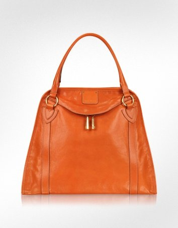 Made of soft goatskin, this punchy, colorful satchel is equal parts fun and functional.  Marc Jacobs Wellington Orange Leather Satchel Bag ($1,295)