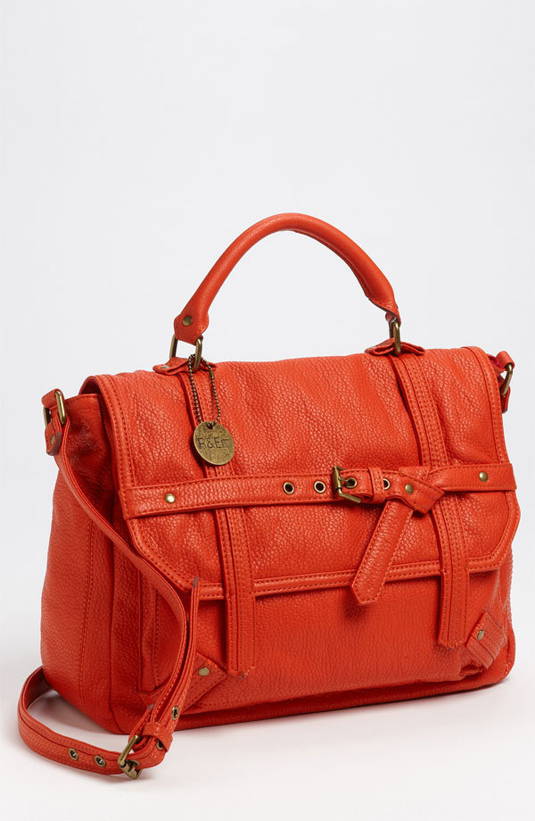 "Crisscrossing belt accents add visual interest to this punchy, textured faux leather satchel. R&Em ""Percy"" Satchel ($95)"