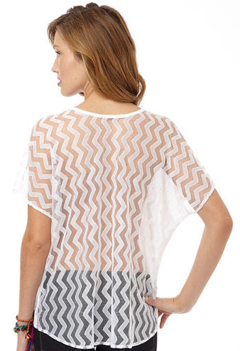 With a sheer, geometric-printed back and a solid white front, it's an ideal option for warm weekends.  Alloy Karla Tee ($25)
