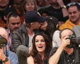 Austin Butler and Vanessa Hudgens shared a passionate kiss at a Lakers game.