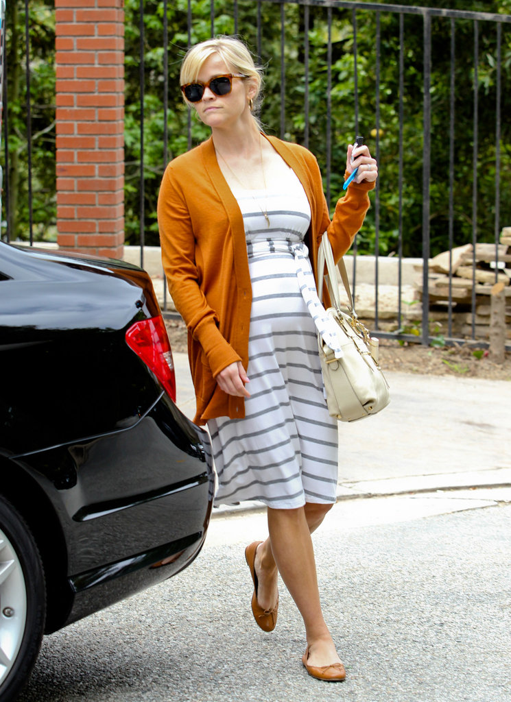 Reese Witherspoon walked back to her car after checking out her new home.