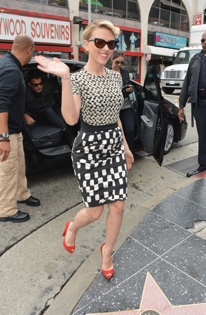 Scarlett Johansson waved upon her arrival.