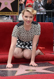 Scarlett Johansson posed next to her name after being presented her star on the Hollywood Walk of Fame.