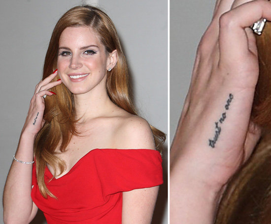"Singer Lana Del Rey has numerous tattoos, and on her right hand the saying, ""trust no one"" and on her left ""paradise."""