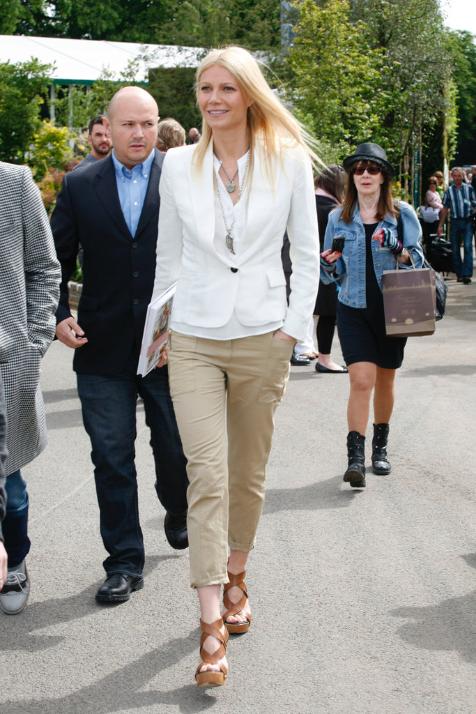 At an appearance for her book in London, Gwyneth opted for a crisp white blazer with equally cool cropped khaki pants.  Get her sharp cargo look below. 6826111