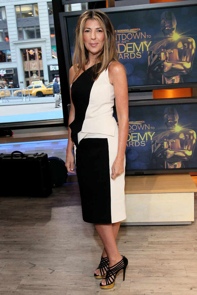 To match with her black-and-white one-shouldered dress, Nina wore strappy gold-platform sandals on Good Morning America.  6820243