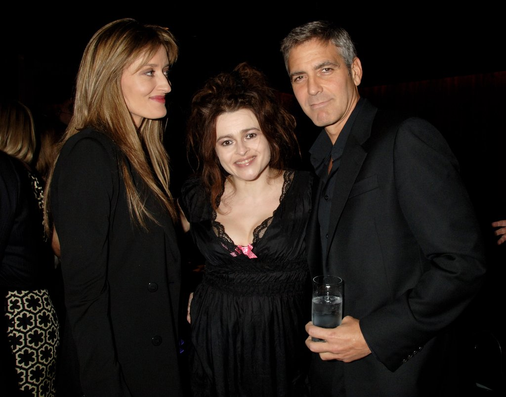Helena Bonham Carter and Natasha McElhone socialized with George Clooney at a London event in April 2008.