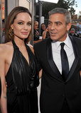 George Clooney and Angelina Jolie stopped for a photo op at the January 2012 SAG Awards.
