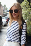 Highlight classic styles like the striped t-shirt with modern accessories.