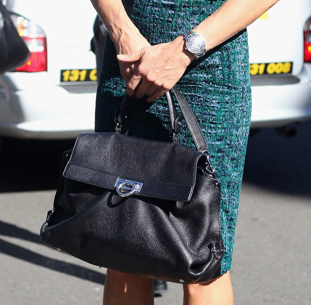 Her chic black bag and men's watch tied her outfit together.